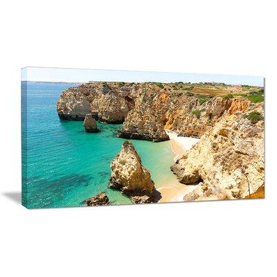 DesignArt Rocky and Rough Portugal Bay Photographic Print...